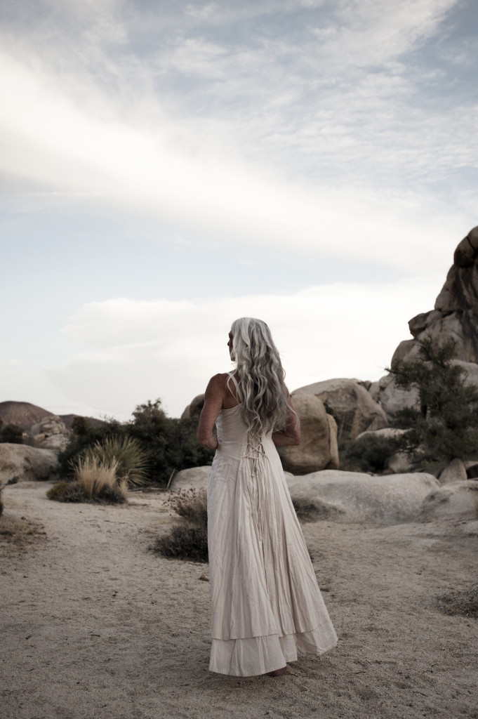 Beautiful mature woman standing in the desert she loves.